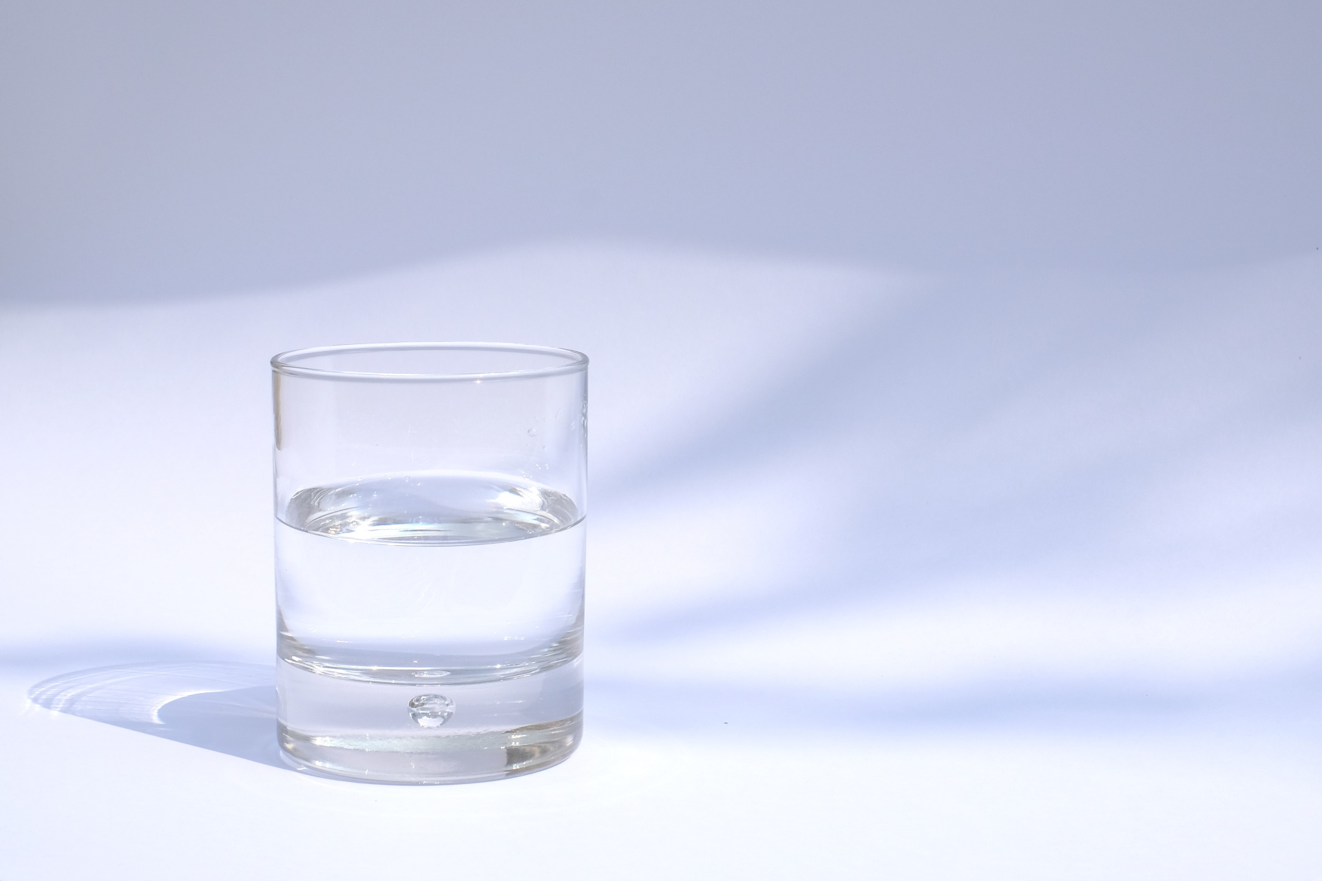 A Glass Of Water On A Light Background