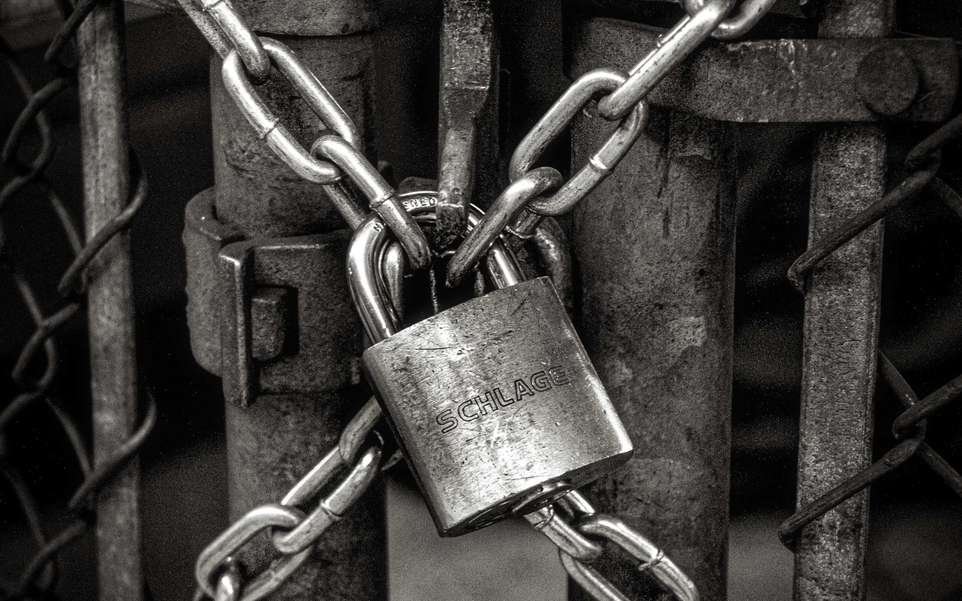 Iron Gate with a Steel Padlock Locking Chains Together
